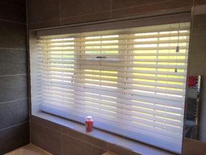 Wooden blinds in bathroom